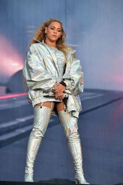 Beyoncé in a futuristic silver metallic jacket and matching boots.