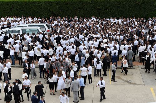 Mourners are seen behind the hearses after the funeral for Anthony Abdallah, 13, Angelina Abdallah, 12, and Sienna Abdallah, 8, at Our Lady of Lebanon Co-Cathedral in Sydney.
