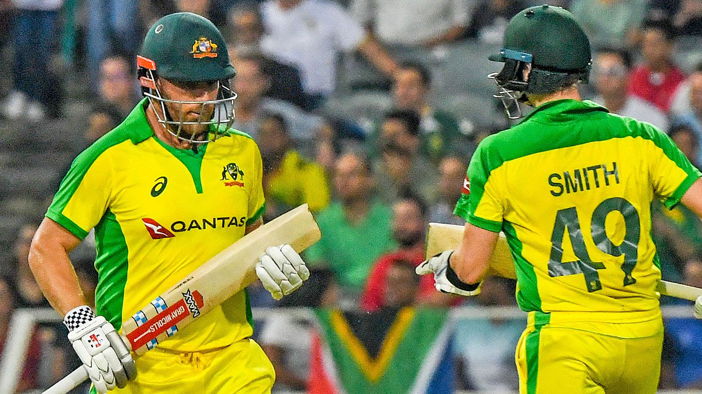 Aaron Finch and Steve Smith of Australia