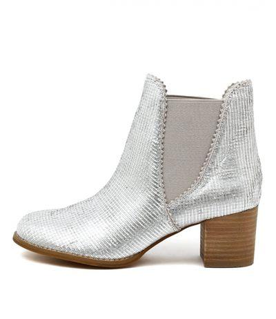 "<a draggable=""false"" href=""https://www.midasshoes.com.au/shadow-lt-silver-cut-leather.html"" target=""_blank"">Midas</a>, silver cut leather boot, $228"