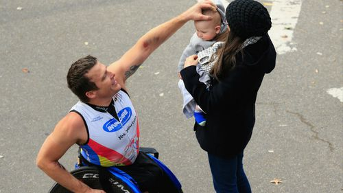 Fearnley celebrates with his family after winning the Pro Pushrim Men's division during the 2014 TCS New York City Marathon in 2014. (Getty)