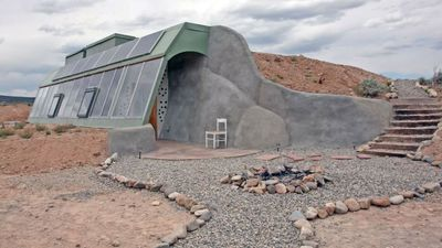 """<p>The owner took three years to build this<a href=""""https://www.airbnb.com.au/rooms/1762491?role=public&sug=50&wl_id=75&wl_source=list"""">offgrid earthship in New Mexico</a>that catches its own rain water, generates its own electricity and stays at a steady 72 degrees all year round without the use of any fuel or electricity. Don't worry, there's Netflix and wifi.</p> <p>$163 AUDper night</p> <p>Photo: Airbnb</p>"""