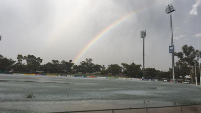 <p>A rainbow forms over a sports field. </p> <p>(Adam Giles)</p>