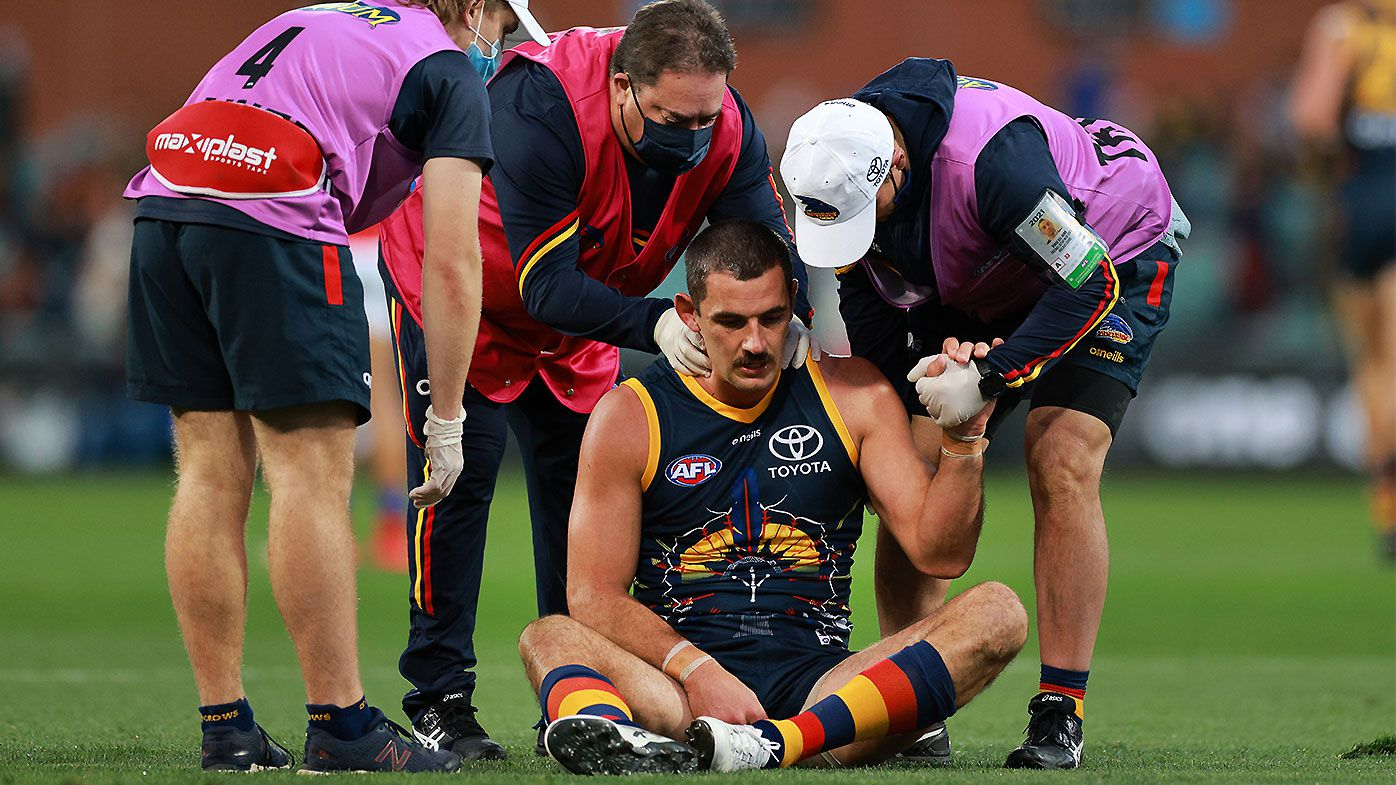 Adelaide veteran Taylor Walker suffers neck injury after frightening head-on collision
