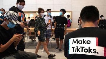 A visitor to an Apple store wears a t-shirt promoting Tik Tok in Beijing