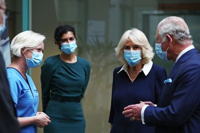 Prince Charles, Prince of Wales and Camilla, Duchess of Cornwall speak to Chief Nursing Officer for England Ruth May during a visit to Skipton House to meet NHS and MOD staff involved in the vaccine rollout on March 9, 2021 in London, England