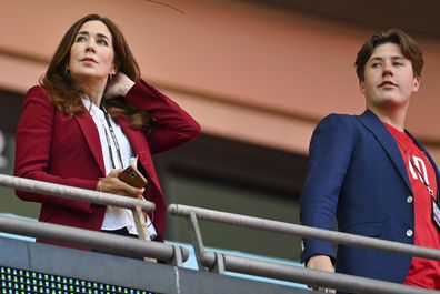 Mary, Crown Princess of Denmark, looks from the stands with her son Prince Christian ahead of the Euro 2020 soccer championship semifinal between England and Denmark at Wembley stadium in London, Wednesday, July 7, 2021. (Justin Tallis/Pool Photo via AP)