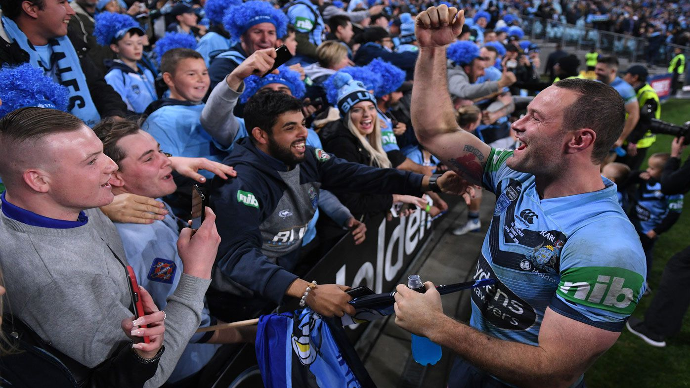 NSW captain Boyd Cordner celebrates with Blues supporters.