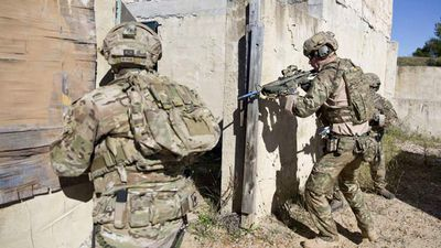 Captain Wales (R), participating in a Counter Terrorism exercise with Australia's 2 Commando Regiment on May 7, 2015.