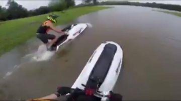 Two Gold Coast jetskiers defy warnings to rip around flooded dog park
