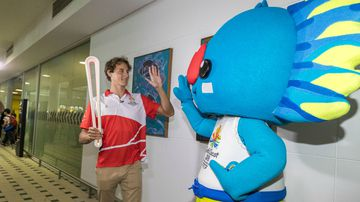 Cam McEvoy with mascot Borobi in Brisbane today. (AAP)