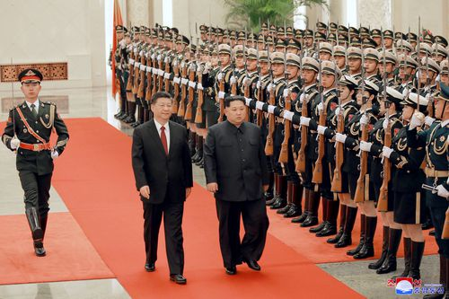 Kim Jong-un and Xi Jinping officially inspect the troops as part of their ceremonial duties. Picture: AAP