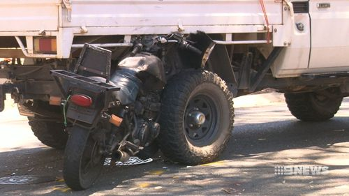 The motorbike rider had been attempting to overtake the ute when the vehicles collided. (9NEWS)