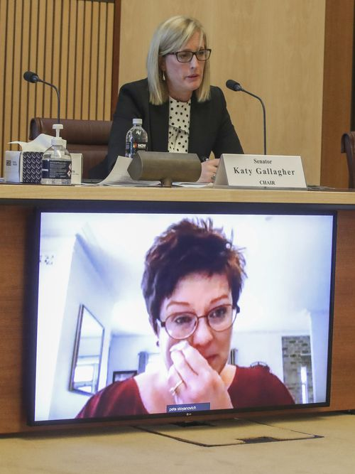 Senator Katy Gallagher  listens as Peta Stoyanovich-Kristie (appearing via video-conference) discusses repatriation and travel issues during a Senate hearing on COVID-19. Photo: Alex Ellinghausen