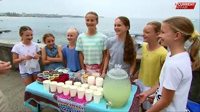 A group of Sydney girls started a lemonade and cake stall to raise money for firefighters.