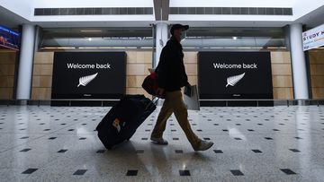 A perfect Sydney airport snapshot to illustrate Australia re-opening its borders to New Zealand under the trans-Tasman bubble. (Photo by James D. Morgan/Getty Images)