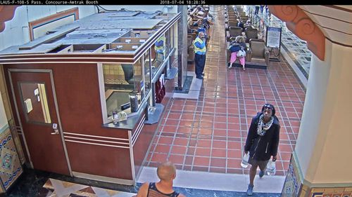 This photo from surveillance video, taken at 6:28 p.m. on Wednesday, July 4, 2018, released by the Los Angeles County Metropolitan Transportation Authority (LA Metro), shows a woman police believe to be the biological mother of a 7-year-old boy, leaving Union Station in downtown Los Angeles after abandoning the boy. Police believe the boy may be deaf or autistic because they hadn't been able to communicate with him. About 19 hours later, the woman returned to the station and was taken into custody Thursday afternoon, July 5. Her name was not released. (LA Metro via AP)