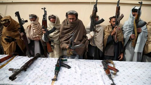 Former Taliban and IS militants surrender their weapons during a reconciliation ceremony in Jalalabad, Afghanistan.