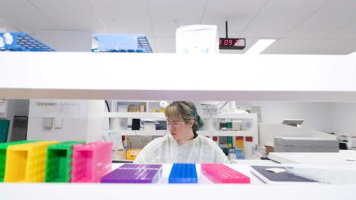 A worker is pictured at the Scientia Clinical Research Ltd lab in Randwick.