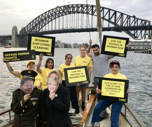Amnesty International protesters in Sydney Harbour this morning. They want to bring more attention to the plight of Rohingya muslims in Myanmar. Picture: AAP)
