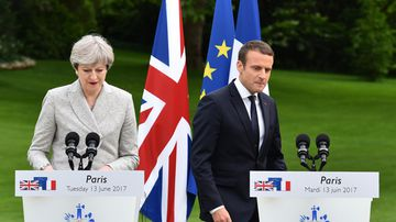 French President Emmanuel Macron and British Prime Minister Theresa May hold a joint press conference after their meeting at the Elysee Palace garden in Paris