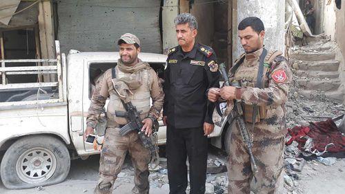 General Abdul Wahab al-Saadi alongside several soldiers. (Owen Holdaway)
