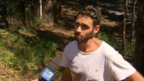 The mates took turns dousing each other in water as they battled the searing blaze. (9NEWS)