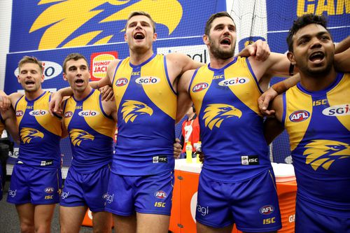Eagles players celebrate after winning the Second Qualifying Final. (AAP)