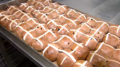 Woolworths and Coles are baking up controversy over the January arrival of the Easter treat. (9NEWS)