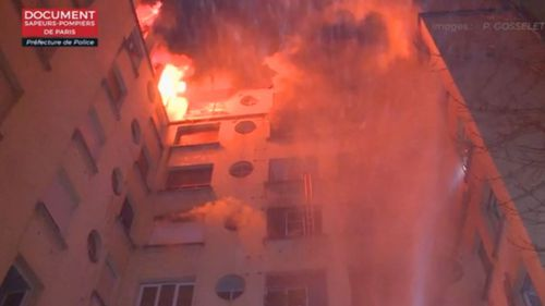 Smoke and flames engulfed the building forcing some residents to jump onto nearby roofs.