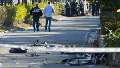 Cyclists were knocked off their bikes as the attack unfolded. (AP)