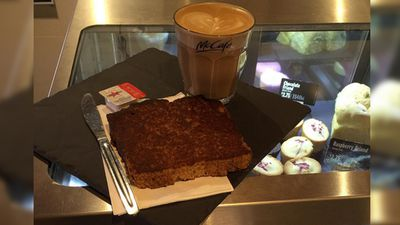 """<p>McCafé's banana bread contains 14 teaspoons of sugar and 2570 kilojoules - about the same amount as a Big Mac - the Cancer Council NSW research found. That's 55 percent of an adult's daily sugar allowance.</p><p>""""That's four times the kilojoules that we should be consuming from a between-meal treat. This is about the same as a McDonald's Big Mac, which we're more likely to have as part of a meal,"""" research co-author Clare Huges said.</p>(Instagram)"""