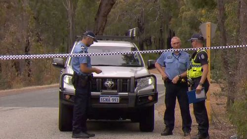 A crime scene is still set up in bushland as police search for clues on what happened to Kym Taylor