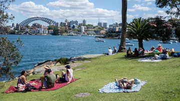 Picnickers gather at Cremorne Point in Sydney on the October long weekend.
