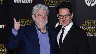 Lucas with the film's director J.J. Abrams. (Getty)