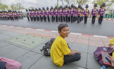 Children watched in awe as the new King of Thailand was celebrated in the procession leading up  to his Royal Coronation.