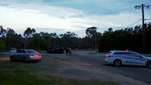 A crime scene has been established at Providence Road, Greenvale after a police car was rammed and a man was shot.