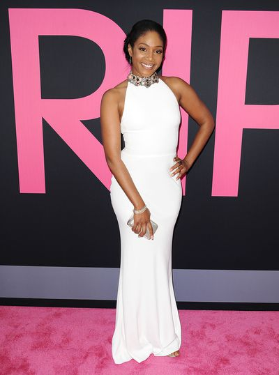 Actress Tiffany Haddish glows in a skin-tight white number at the premiere of her movie 'Girls Trip' in 2017.