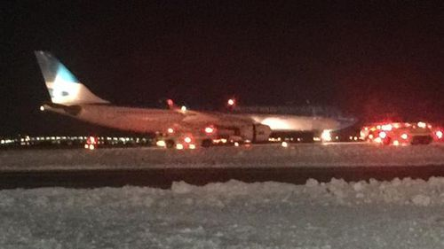 Plane on fire at JFK airport, US media reports