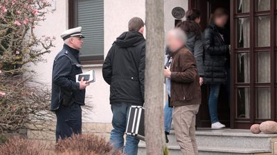 Police enter a house in Montabaur, Germany, believed to be that of Lubitz, to search for clues in the investigation. (AAP)