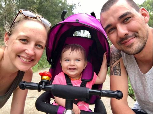 Volunteer firefighter Andrew O'Dwyer with his partner Mel with their young daughter Charlotte. (Facebook)