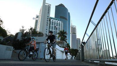 People walking near the Brisbane CBD after lockdown began on July 31, 2021 in Brisbane.