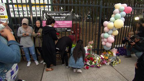 Members of the community observed a minute of silence at the vigil. (9NEWS)