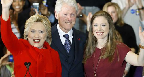 Hillary Clinton with her husband Bill and daughter Chelsea. (AAP)