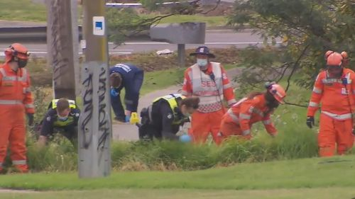 Police and SES search the grounds of nearby carparks for signs of a weapon.