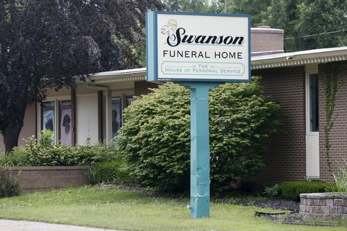 The Swanson Funeral Home's licences were suspended after maggots were found on the floor. (Associated Press)