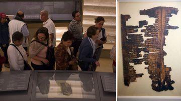 Museumgoers view the Genesis Apocryphon. (AAP)