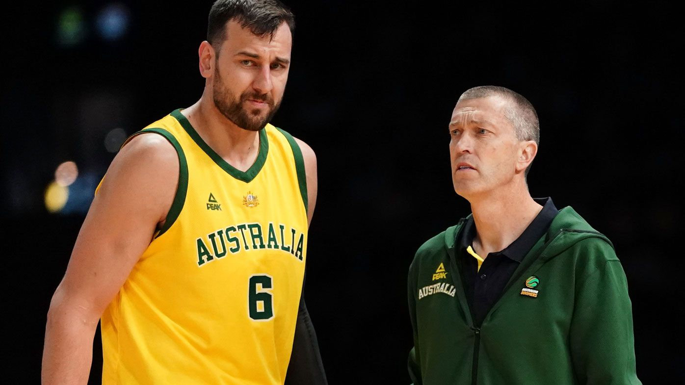 Andrew Bogut of Australia talks with Coach Andrej Lemanis