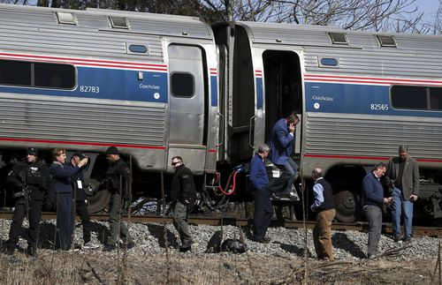 The GOP lawmakers helped passengers off the train after the crash. (AAP)