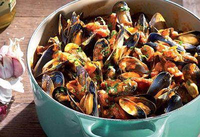 Mussels and chorizo with tomato ragout on garlic toast